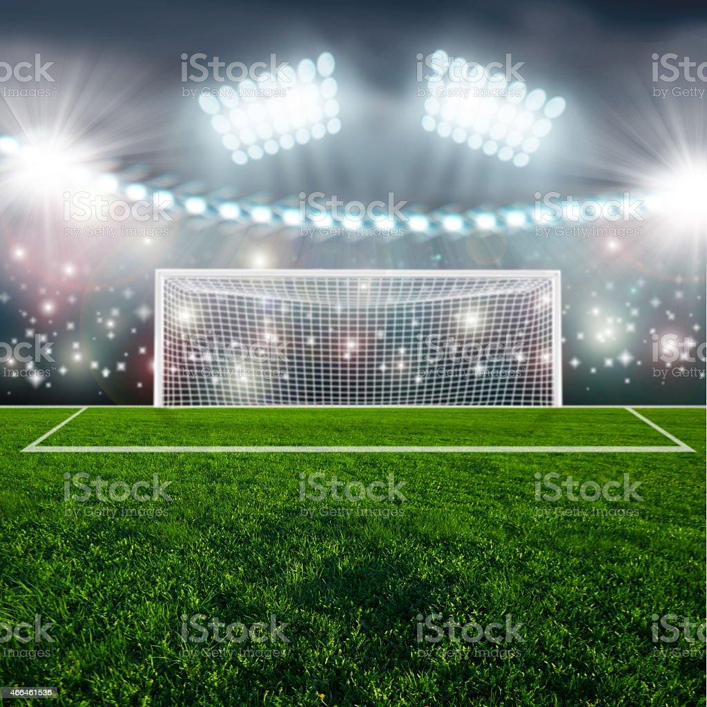 Soccer ball on green stadium arena stock photo