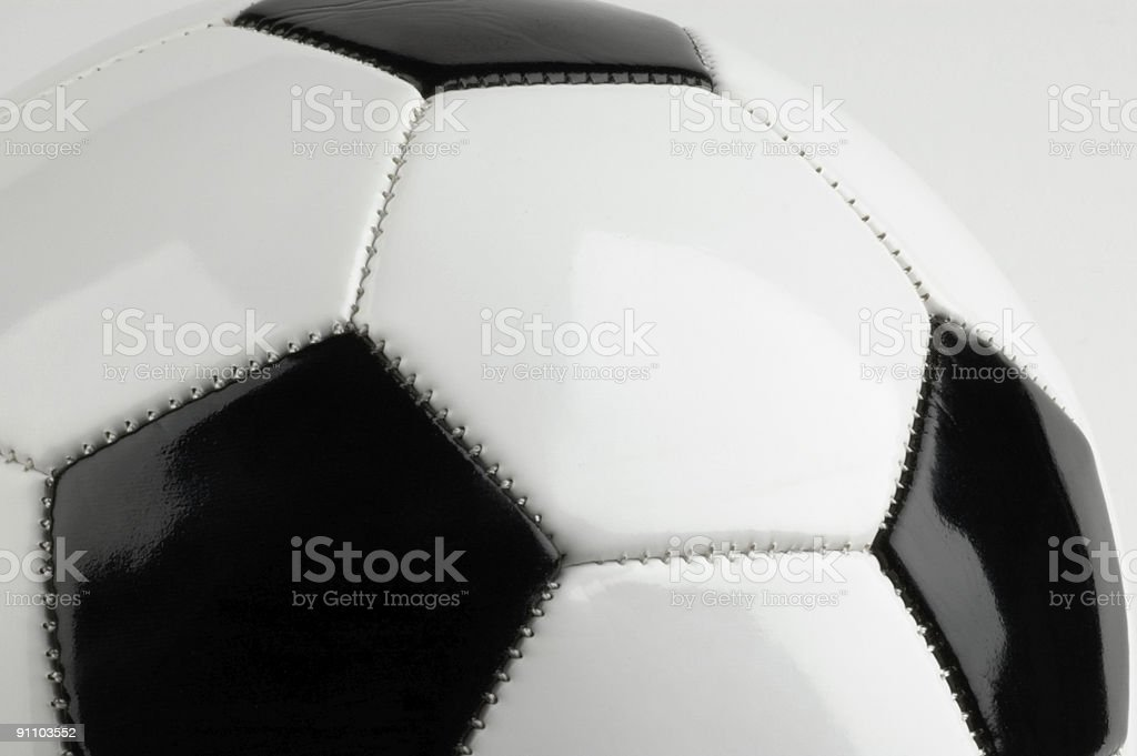 Soccer ball on grey background royalty-free stock photo