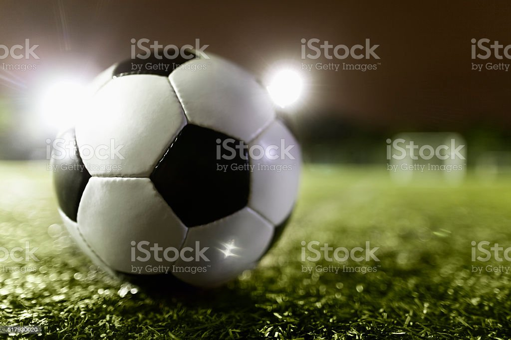 Soccer ball on sports field stock photo