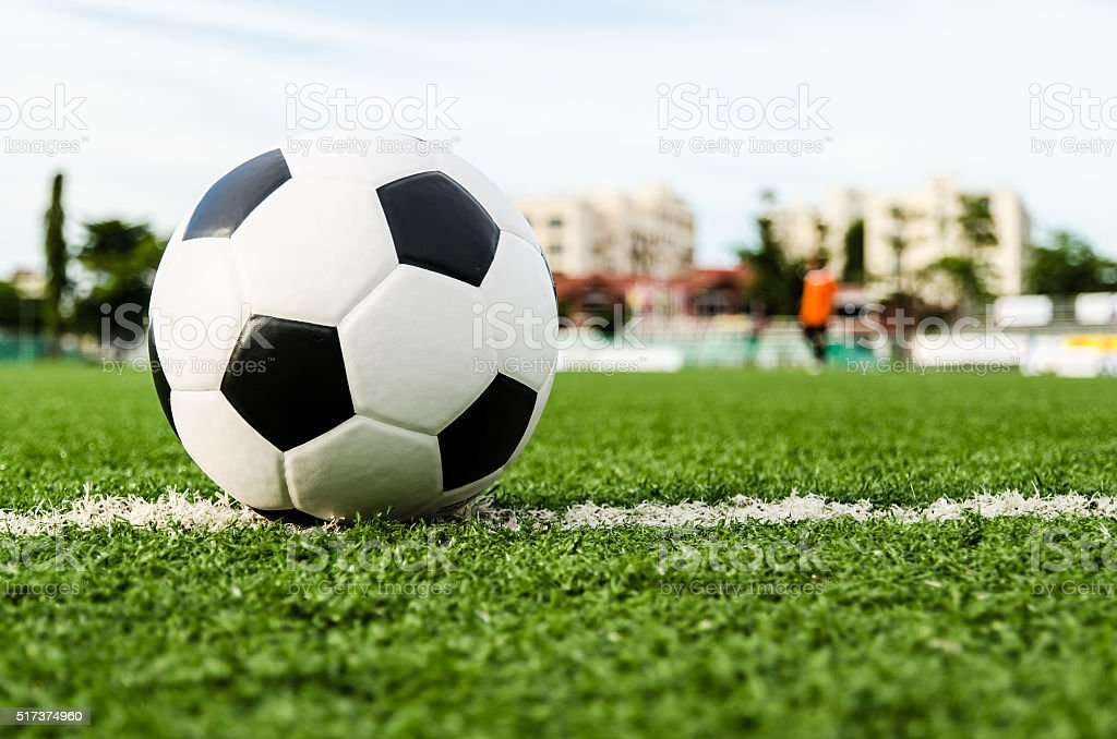 Soccer ball on the green grass of Soccer field. stock photo