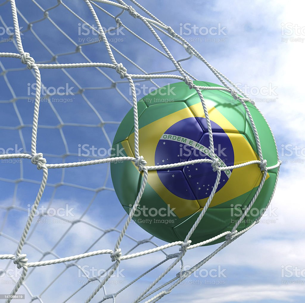 Soccer ball painted with Brazil flag representing World Cup royalty-free stock photo