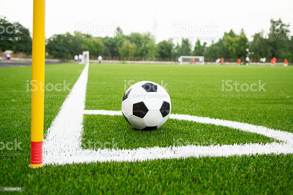 Soccer ball waiting for a corner kick. stock photo
