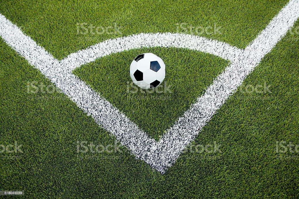 Soccer ball waiting for a corner kick. stock photo