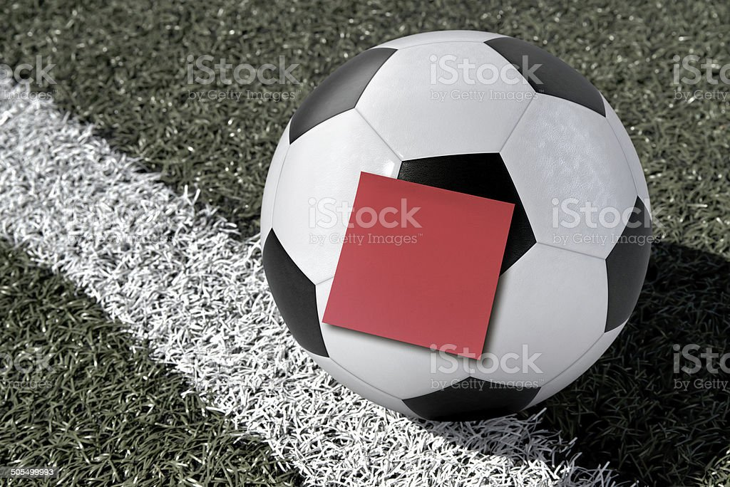 Soccer Ball with a Sticky Note on a Soccer Field royalty-free stock photo