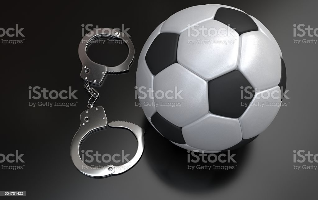 Soccer ball with handcuffs stock photo