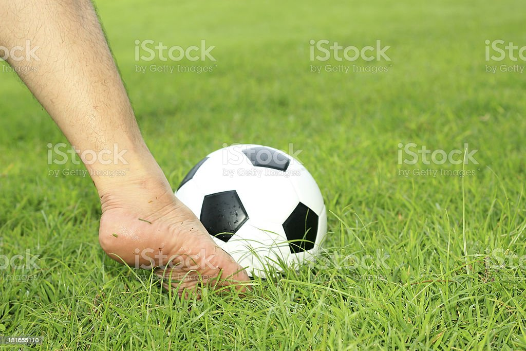 soccer ball with his feet royalty-free stock photo