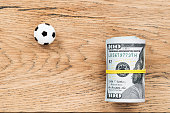 Soccer ball with money on a board