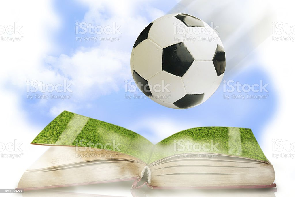 Soccer ball with opened book royalty-free stock photo