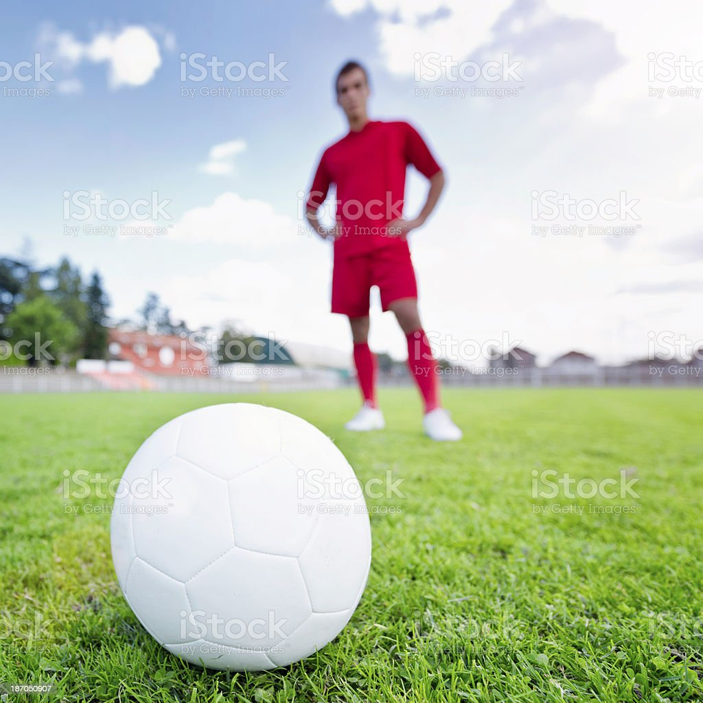 Soccer ball with player in background royalty-free stock photo