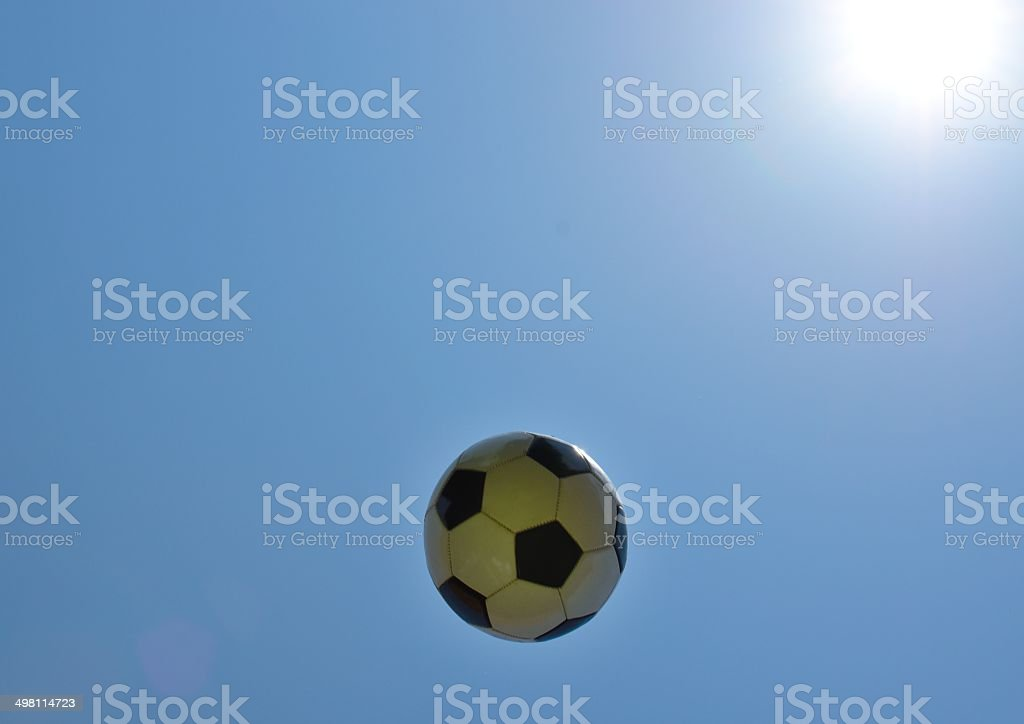Soccer ball with sky as background. stock photo