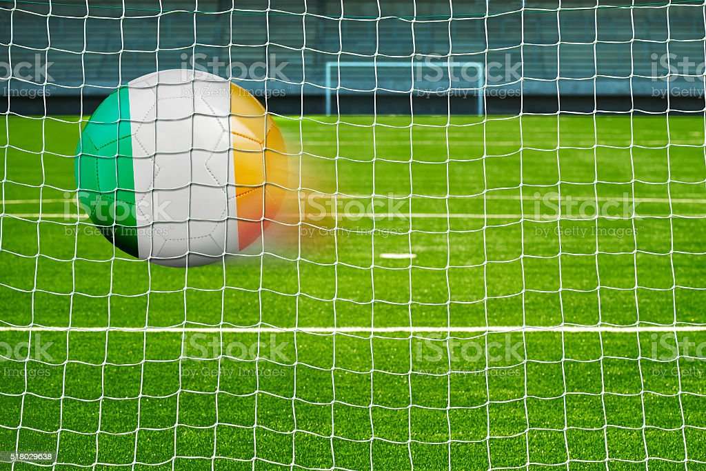 Soccer ball with the flag of Republic-Ireland in the net stock photo