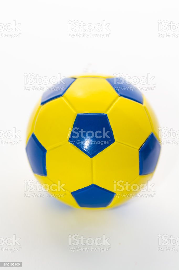 Soccer ball yellow-blue on a white background isolated stock photo