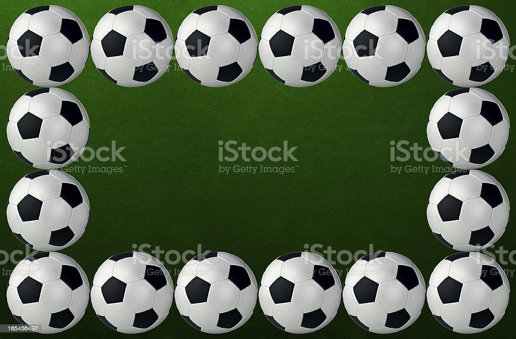 soccer balls on pitch royalty-free stock photo