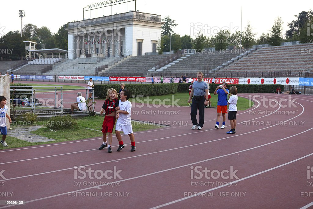 Soccer boys and coach in Milan Arena, Italy royalty-free stock photo