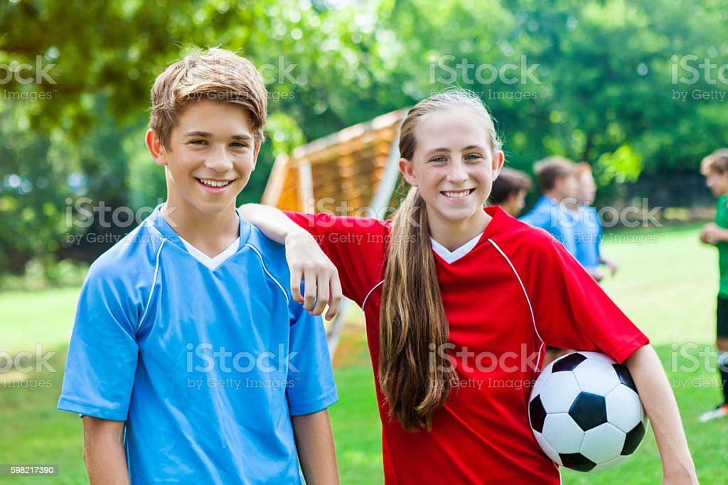 Soccer buddies during soccer practice stock photo