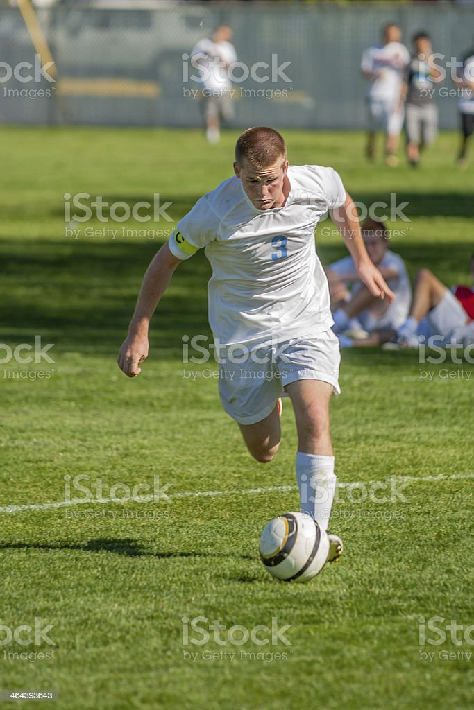Soccer Captain Concentrates on Ball royalty-free stock photo