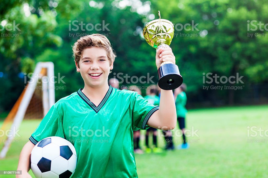 Soccer champ with trophy stock photo