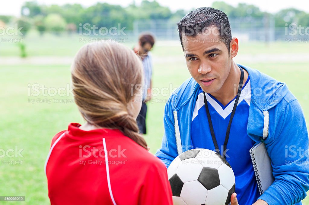 Soccer coach encourages player before game stock photo
