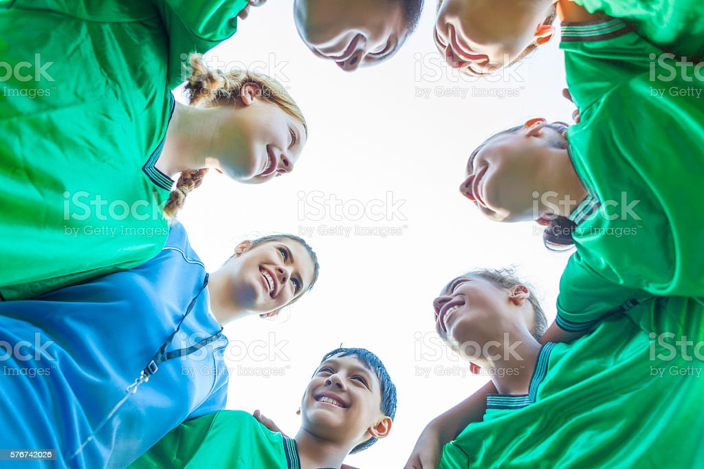 Soccer coach huddles with team during time out stock photo