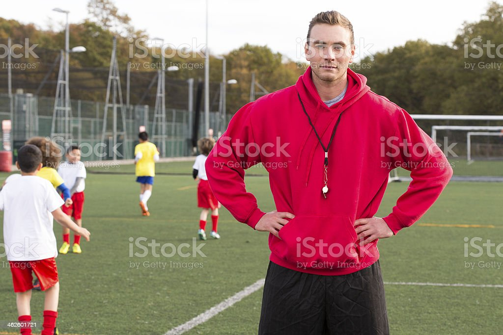 Soccer Coach On The Pitch stock photo