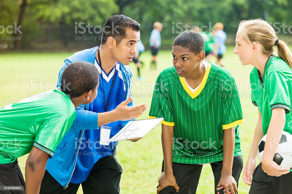 Soccer coach talks about play during time out stock photo