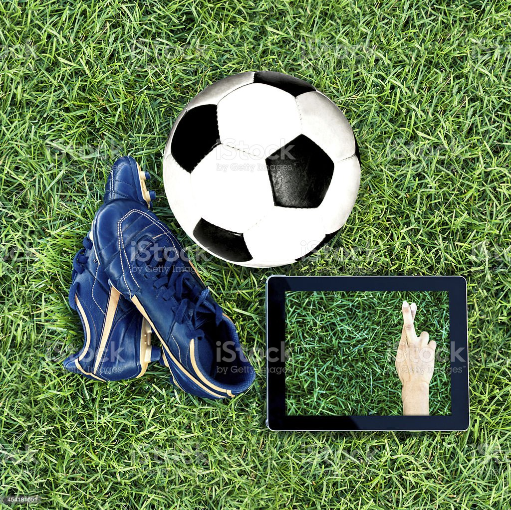 Soccer concepts - Fingers crossed stock photo