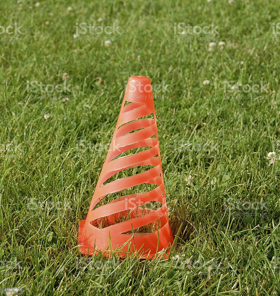 soccer cone standing on grass royalty-free stock photo