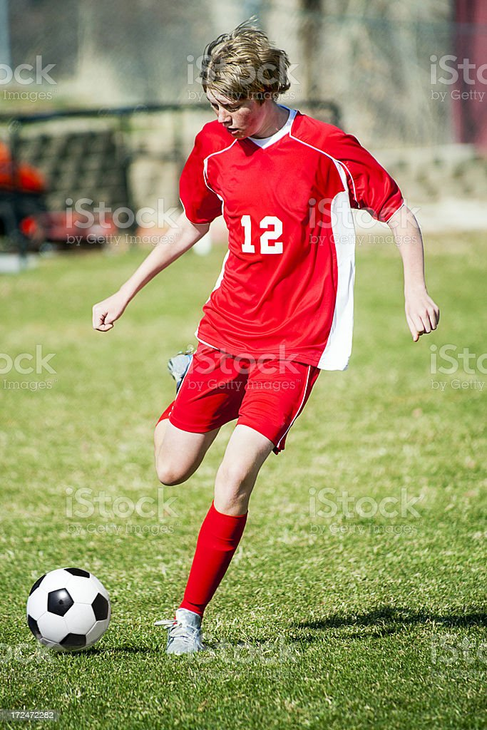 Soccer Controlled Kick Red Uniform royalty-free stock photo