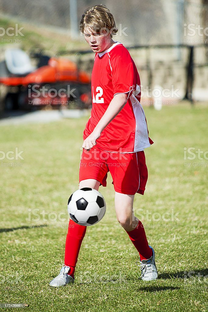 Soccer Defender Watches Controlled Kick royalty-free stock photo