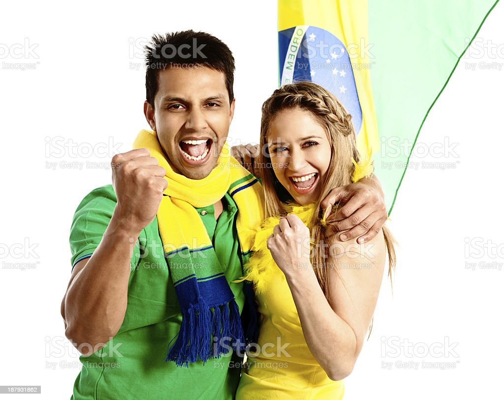 Soccer fan couple in Brazilian colors cheer on their team royalty-free stock photo