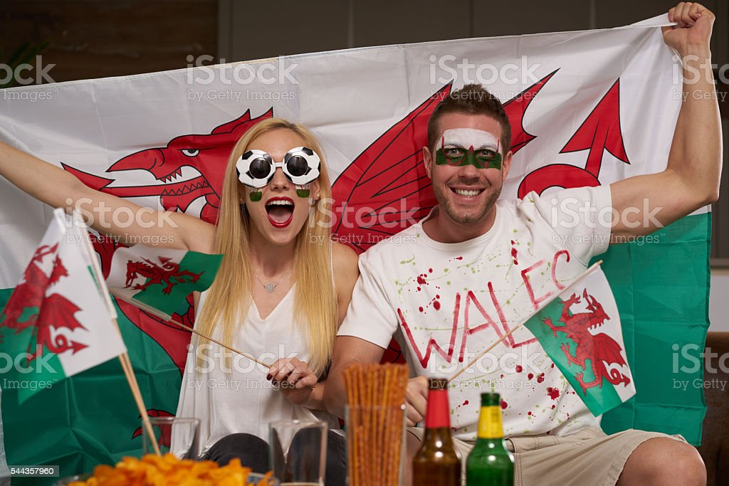 soccer fan couple supporting Wales stock photo