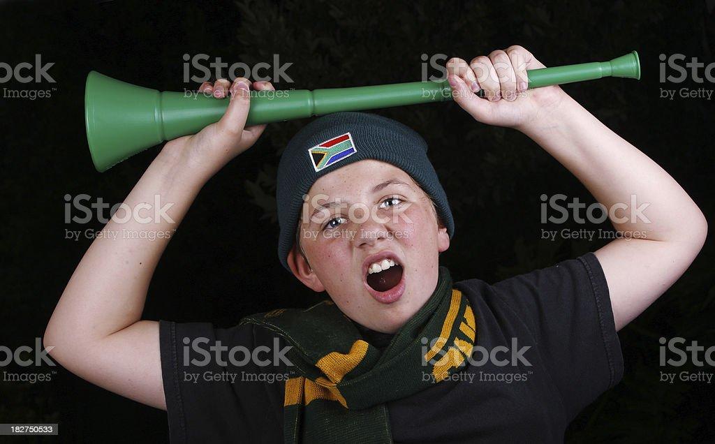 Soccer fan holding a Vuvuzela royalty-free stock photo
