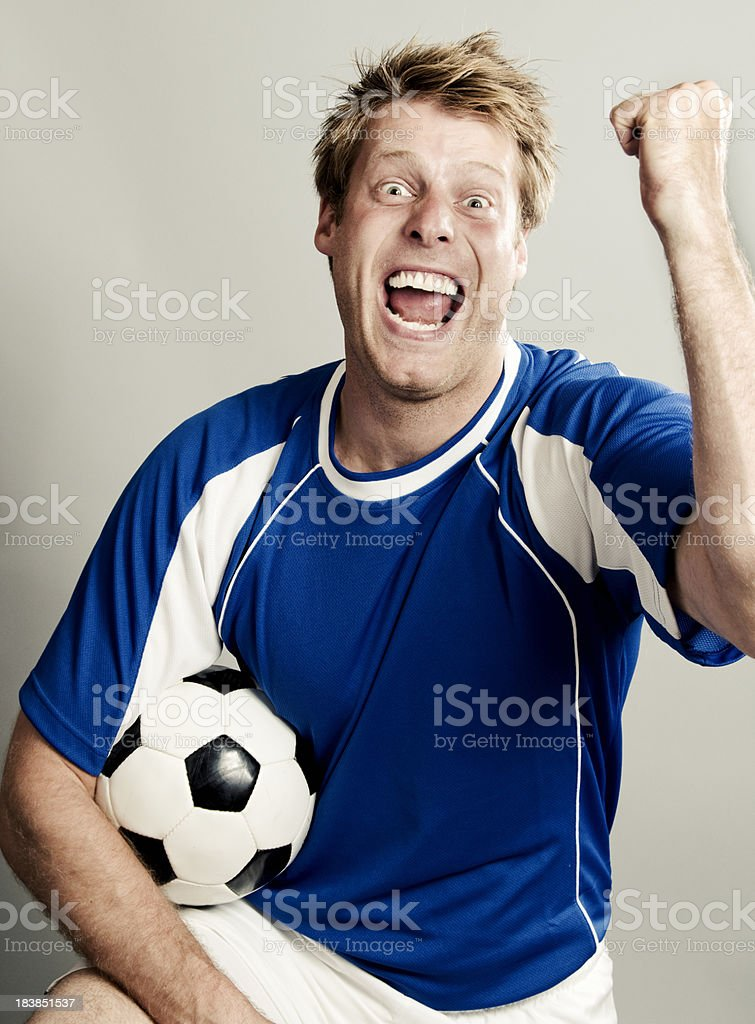 Soccer fan is over estatic royalty-free stock photo