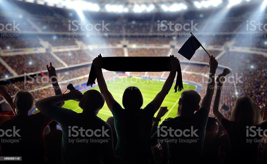 Soccer fans at stadium stock photo