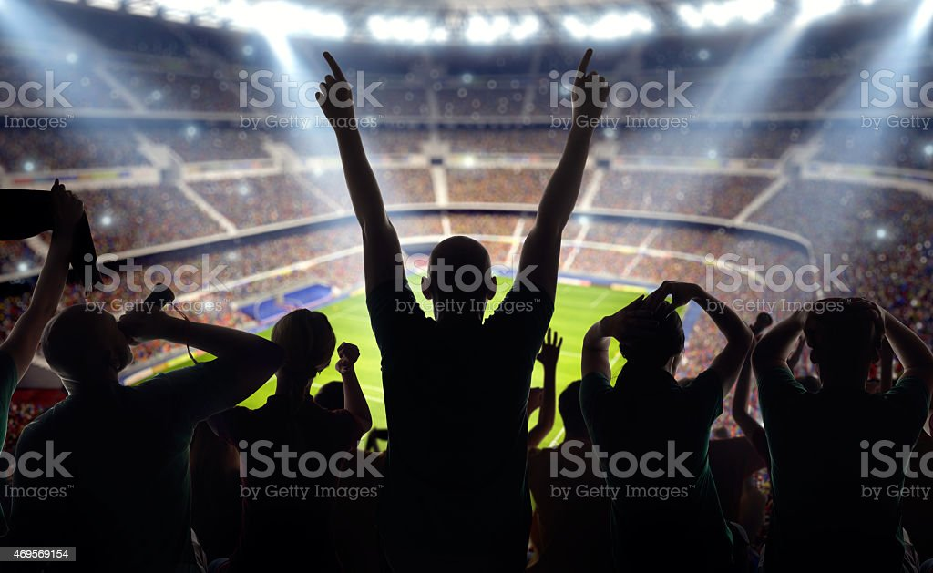 Soccer fans at stadium stock photo