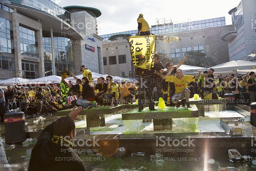 soccer fans celebrating royalty-free stock photo