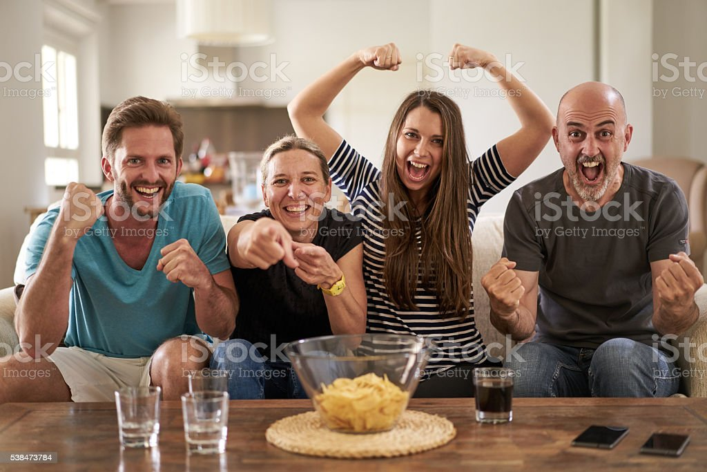 soccer fans in front of tv stock photo