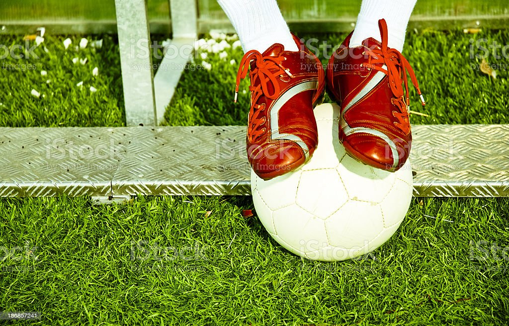 Soccer feet and ball royalty-free stock photo