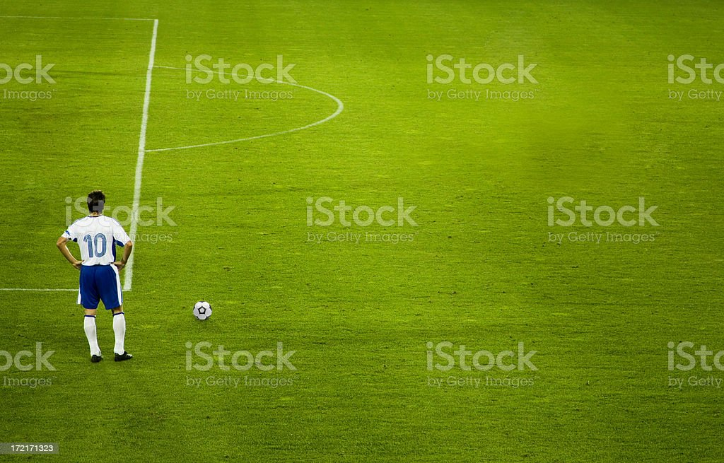 soccer field and player with space for copy royalty-free stock photo