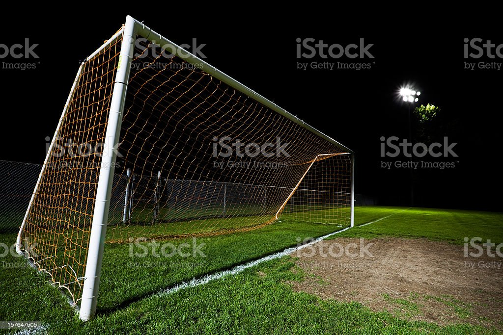 Soccer field at night with red net royalty-free stock photo