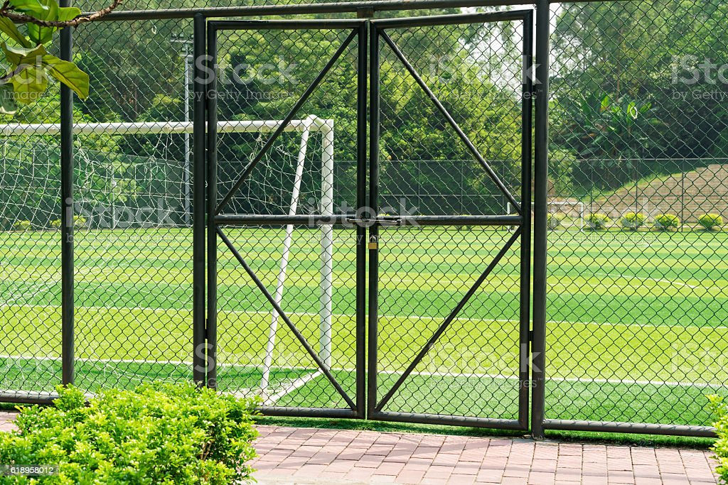 soccer field being locked with padlock stock photo