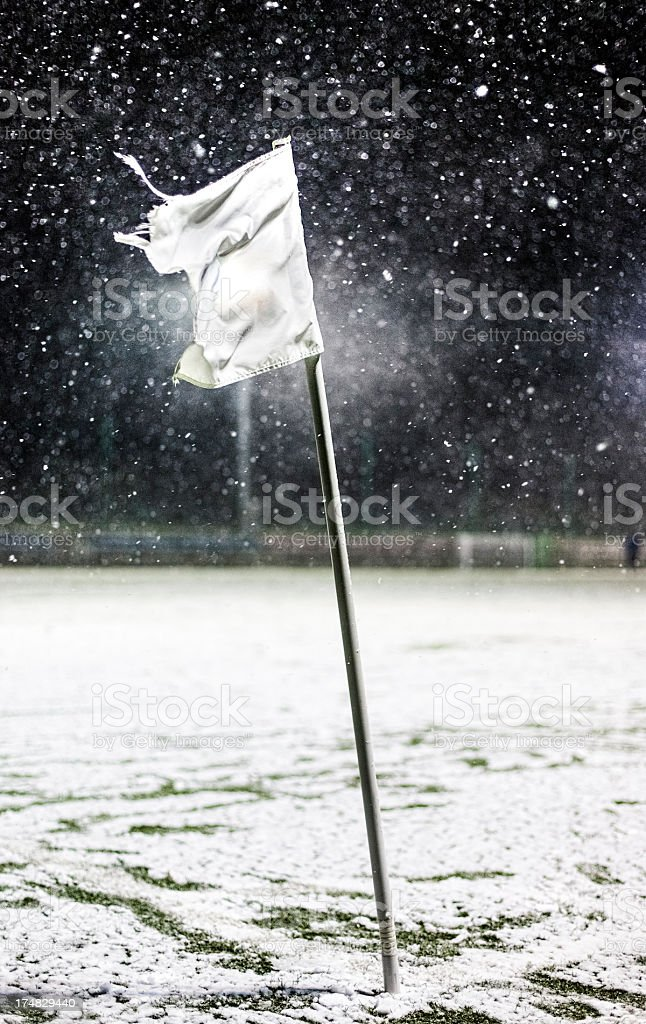 Soccer field covered in snow royalty-free stock photo