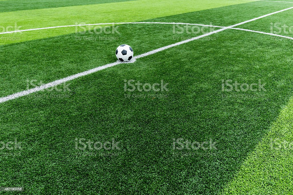 soccer field grass with ball at kick off point. vector art illustration