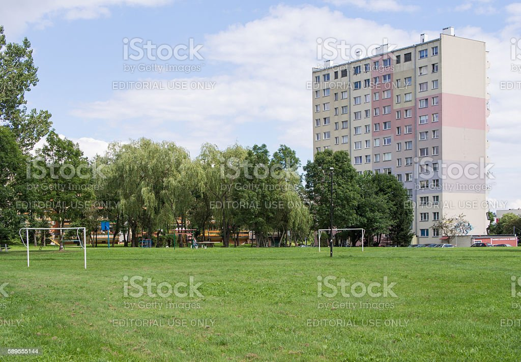 soccer field in front of industrialized apartment block, Jelenia Gora stock photo