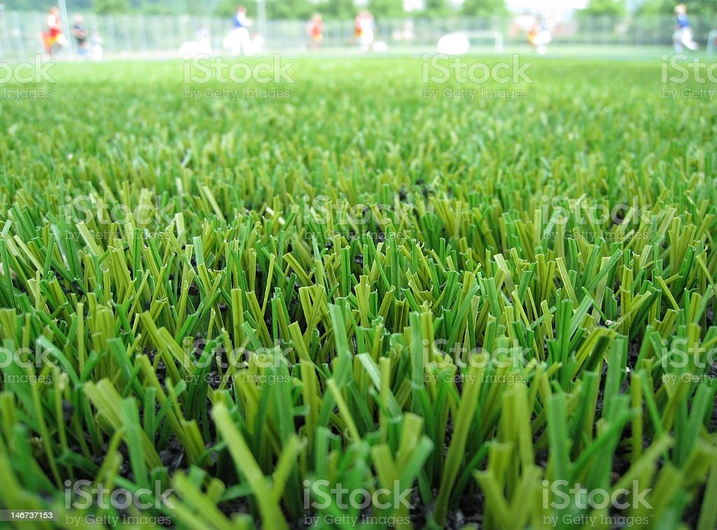 Soccer field made of artificial grass stock photo