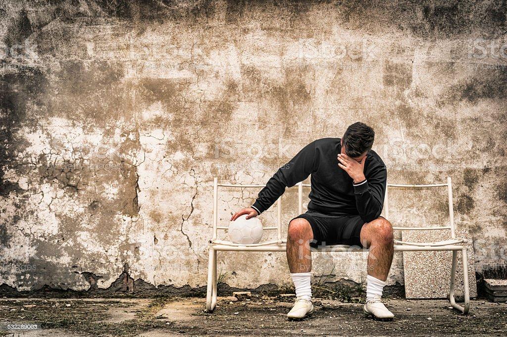 Soccer football goalkeeper feeling desperate after sport failure stock photo