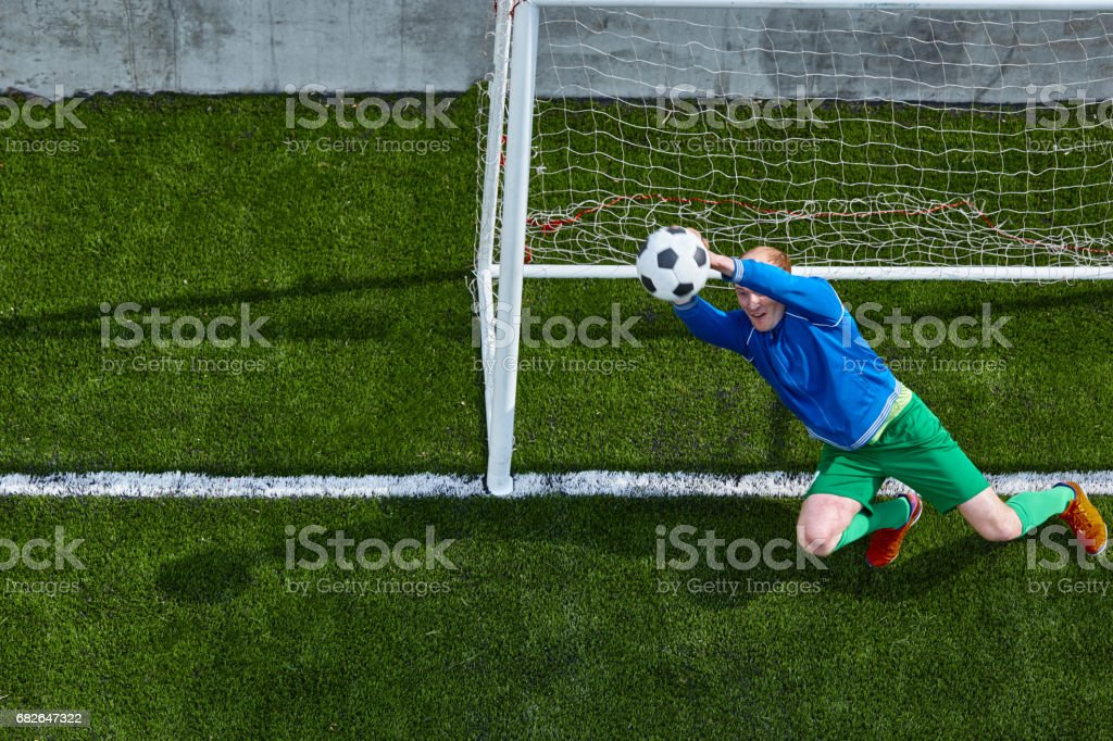 Soccer football goalkeeper making diving save stock photo