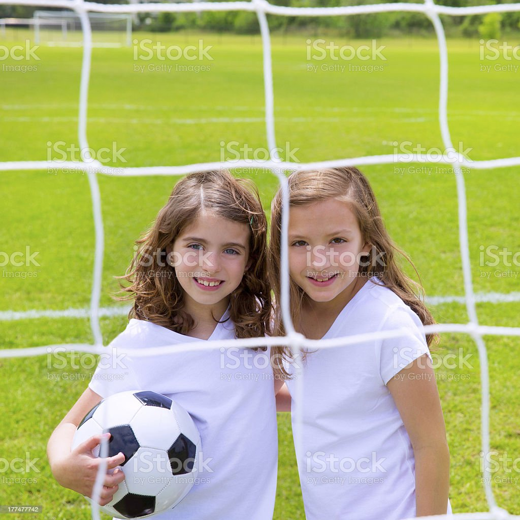 Soccer football kid girls playing on field royalty-free stock photo
