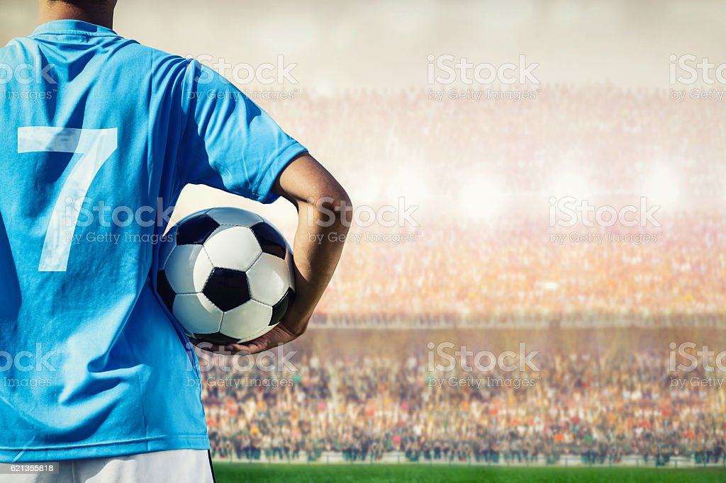 soccer football player in blue team concept holding soccer ball stock photo