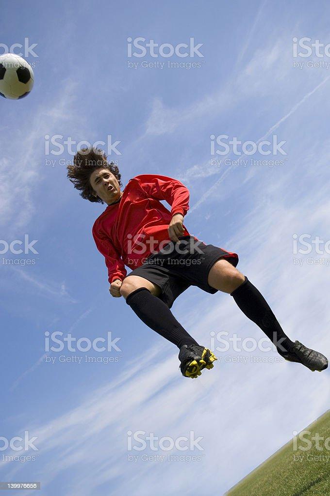 Soccer Football Player making Header royalty-free stock photo